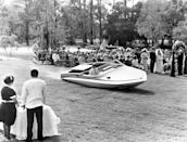 <p>Roger Moore glides out of the water in a motorboat in the Bond film <em>Live and Let Die</em> in 1973.</p>