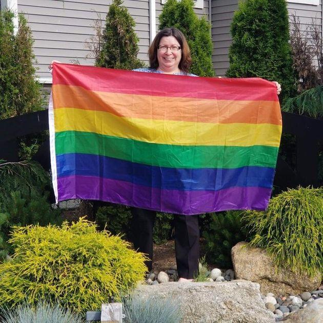 Aldergrove resident Lisa Ebenal hung the first flag on a sign on her private property as a show of support for the LGBTQ community.