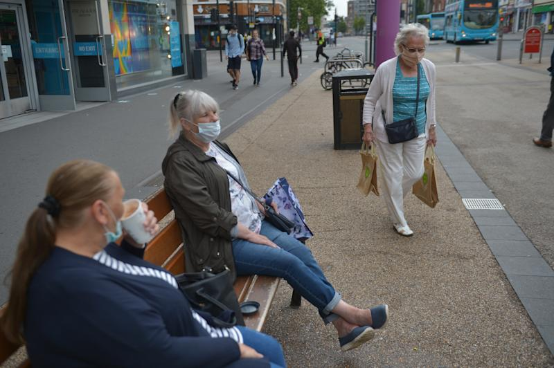 People wearing masks in Leicester city centre as face coverings become mandatory in shops and supermarkets in England. (Photo by Jacob King/PA Images via Getty Images)