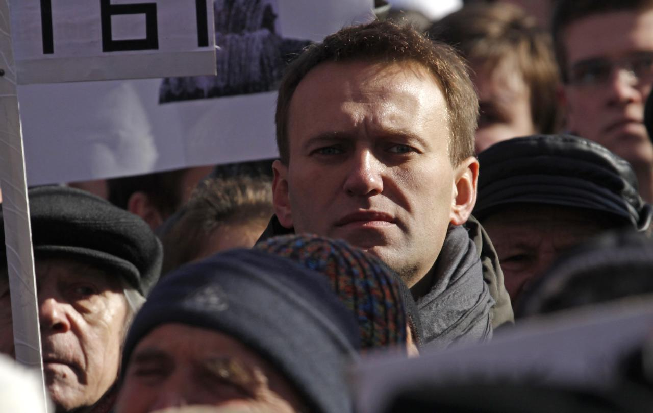 Russian opposition leader Alexei Navalny, center, stands among the other protesters during a rally in Moscow, Russia, Saturday, March 10, 2012. The demonstrators gathered in central Moscow to protest electoral fraud. Saturday's rally is widely seen as evidence of whether the opposition is able to maintain its strength after Vladimir Putin on Sunday won a return to the Kremlin. (AP Photo/Ivan Sekretarev)
