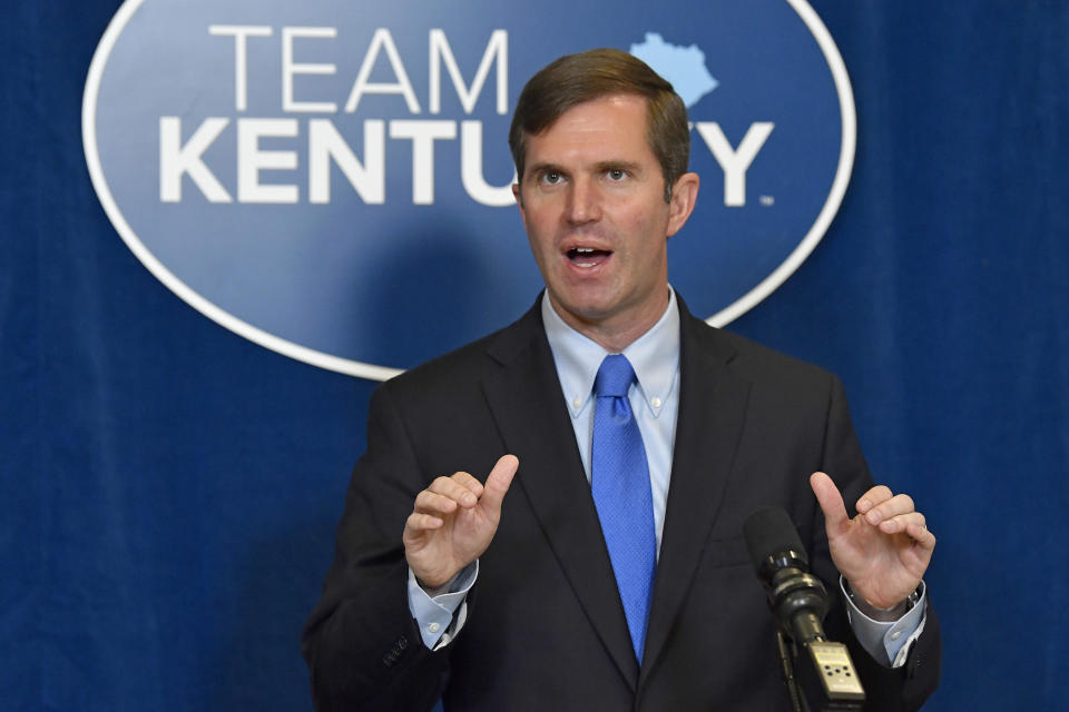 Kentucky Governor Andy Beshear speaks to reporters following the signing of bills related to the American Rescue Plan Act at the Kentucky State Capitol in Frankfort, Ky., Wednesday, April 7, 2021. (AP Photo/Timothy D. Easley)