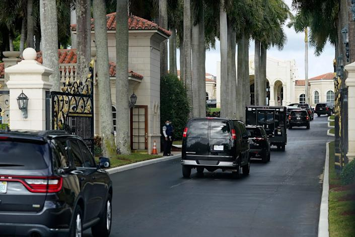 President Donald Trump's motorcade arrives at Trump International Golf Club in West Palm Beach on Dec. 24, 2020.