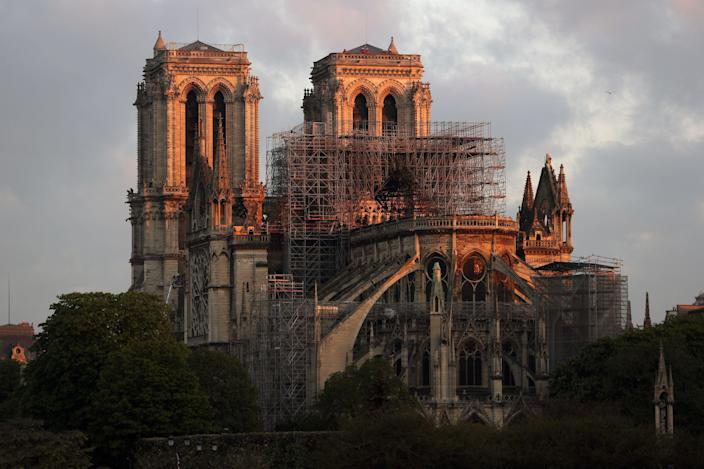 PARIS, FRANCE - APRIL 17: Notre-Dame Cathedral is seen at sunrise following a major fire on Monday on April 17, 2019 in Paris, France. A fire broke out on Monday afternoon and quickly spread across the building, causing the famous spire to collapse. The cause is unknown but officials have said it was possibly linked to ongoing renovation work. (Photo by Dan Kitwood/Getty Images)