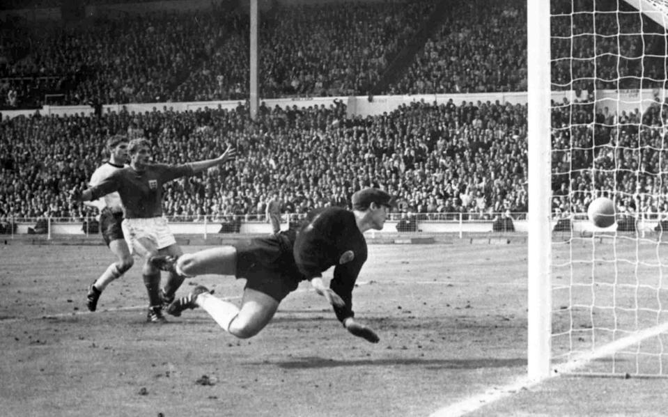 In this July 30, 1966 file photo, England's Roger Hunt, center, raises his arms as Geoff Hurst scores England's third goal past German goalkeeper Hans Tilkowski, right, during the Football World Cup Final at Wembley Stadium, London - BIPPA