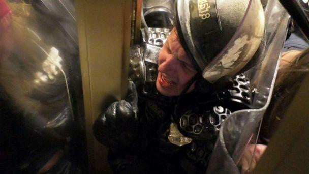 PHOTO: Officer Daniel Hodges of the Washington, D.C. Metropolitan Police Department is crushed in a doorway to the Capitol during the riot on Jan. 6, 2021, in Washington. (Jon Farina/Status Coup)