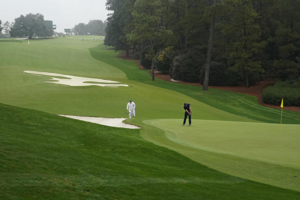 Bryson DeChambeau putts on the 10th green during a practice round for the Masters golf tournament Wednesday, Nov. 11, 2020, in Augusta, Ga. (AP Photo/Charlie Riedel)