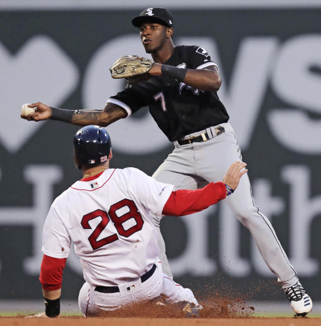 Chicago White Sox shortstop Tim Anderson (7) forces out Boston Red Sox's J.D. Martinez (28), who breaks up a double play on a single by Rafael Devers, during the fourth inning of a baseball game at Fenway Park in Boston, Monday, June 24, 2019. (AP Photo/Charles Krupa)