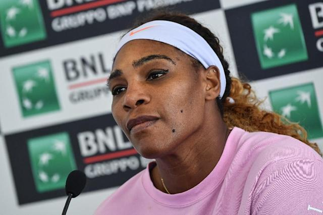 Serena Williams withdrawal hands a third round ticket to sister Venus. (AFP Photo/Andreas SOLARO)
