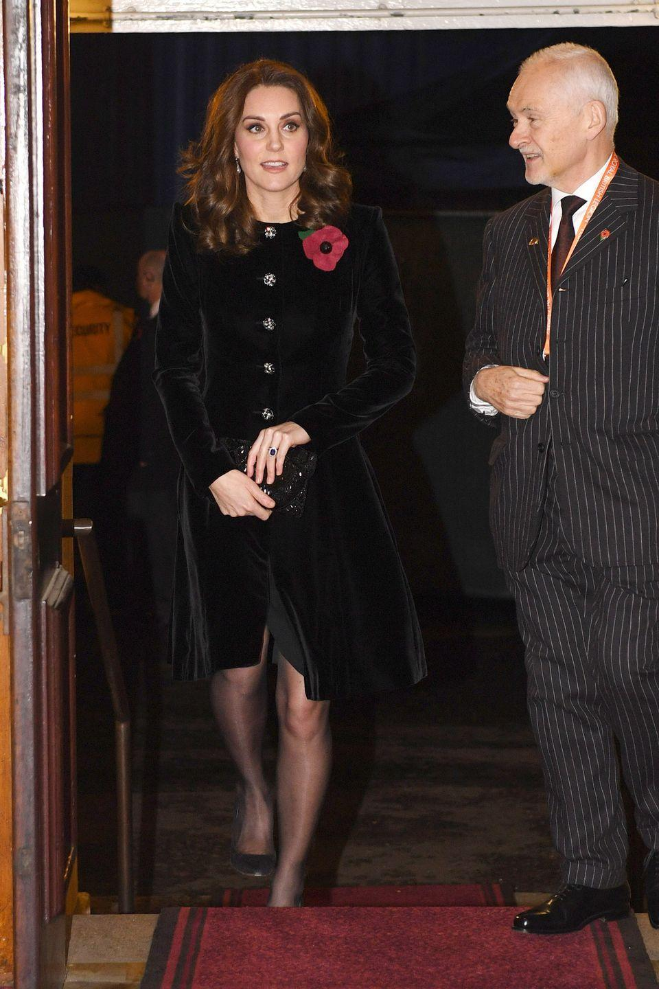 <p>Middleton wears a velvet coat dress by Catherine Walker & Co., black stockings, Gianvito Rossi pumps, and a beaded clutch by Magid at the Remembrance Day service. </p>