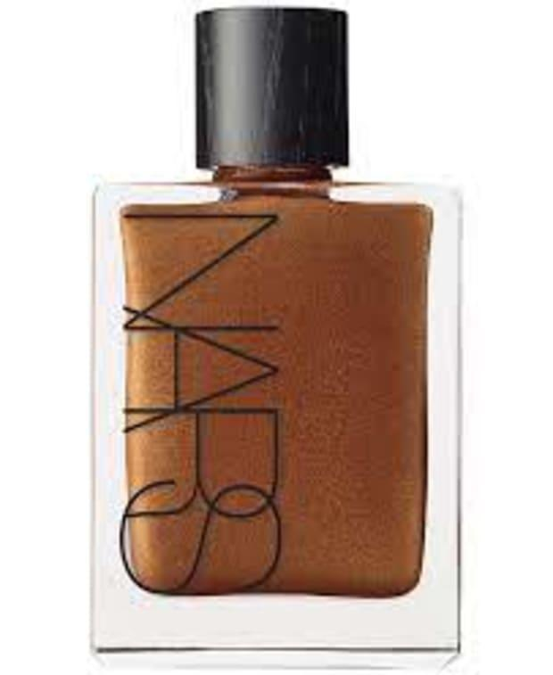"""<p>Nars Monoi Body Glow I, $59, <a href=""""https://shop-links.co/1746216265589300400"""" rel=""""nofollow noopener"""" target=""""_blank"""" data-ylk=""""slk:available here"""" class=""""link rapid-noclick-resp"""">available here</a>.</p>"""