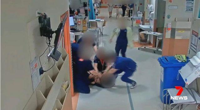 It too six hospital employees to break the chokehold and free the doctor before security guards and police swooped to arrest the man. Source: 7 News