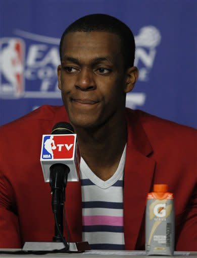 Boston Celtics' Rajon Rondo (9) grimaces during the post-game news conference following Game 2 in their NBA basketball Eastern Conference finals playoffs series against the Miami Heat, Wednesday, May 30, 2012, in Miami. The Heat defeated the Celtics 115-111 in overtime. Rondo scored 44 points. (AP Photo/Wilfredo Lee)