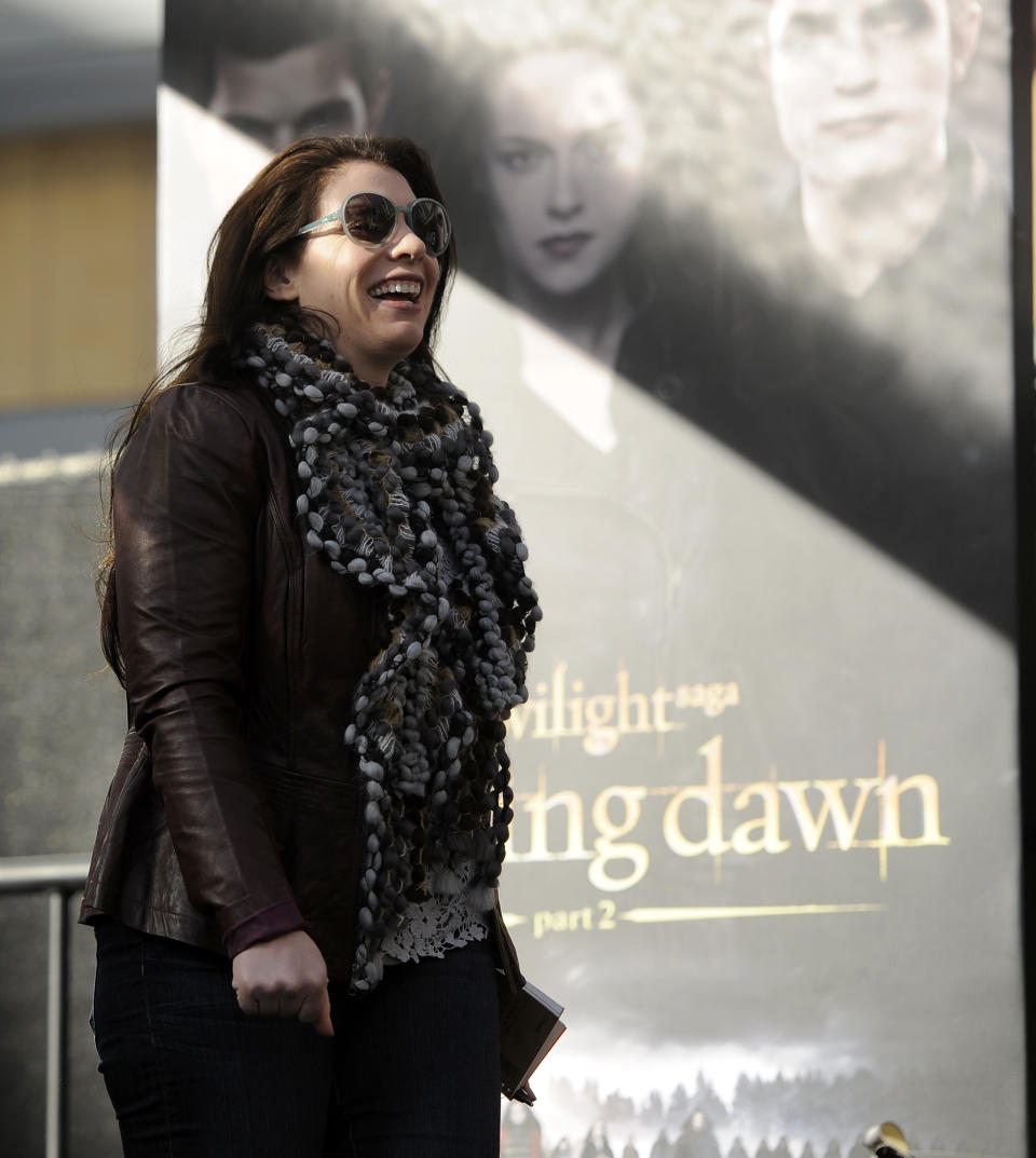 """Stephanie Meyer, author of the series of """"Twilight"""" novels, arrives onstage during the Twilight Fan Camp Concert outside Nokia Theater L.A. Live, Saturday, Nov. 10. 2012, in Los Angeles. The world premiere of the film """"The Twilight Saga: Breaking Dawn - Part 2"""" will be held at Nokia Theater L.A. Live on Monday. (Photo by Chris Pizzello/Invision/AP)"""