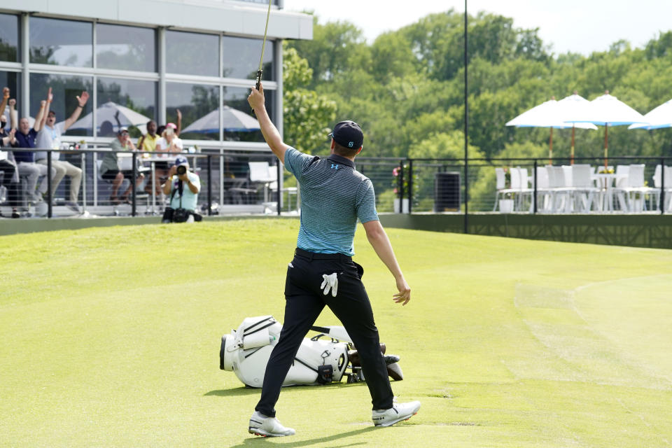 Jordan Spieth reacts to his eagle putt on the 18th green during the third round of the AT&T Byron Nelson golf tournament, Saturday, May 15, 2021, in McKinney, Texas. (AP Photo/Tony Gutierrez)