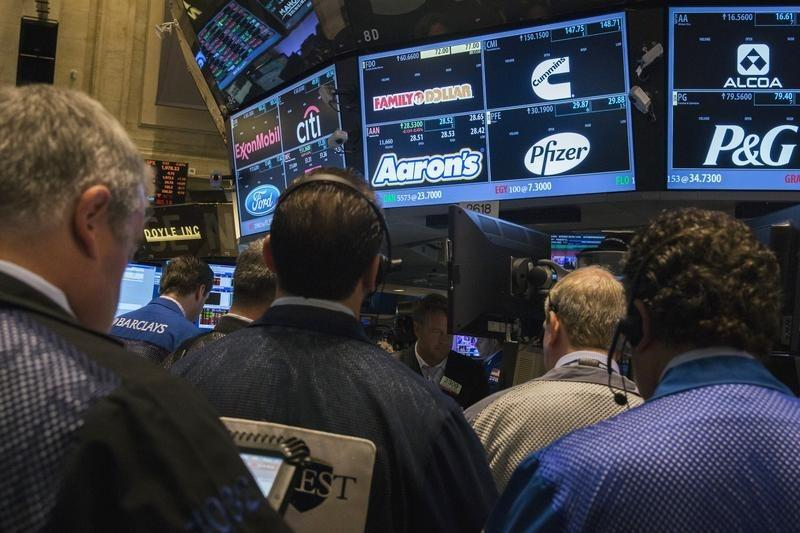 """Traders inquire about the price of the stock for the company """"Family Dollar"""" as they work on the floor of the New York Stock Exchange shortly after the market's opening in New York"""