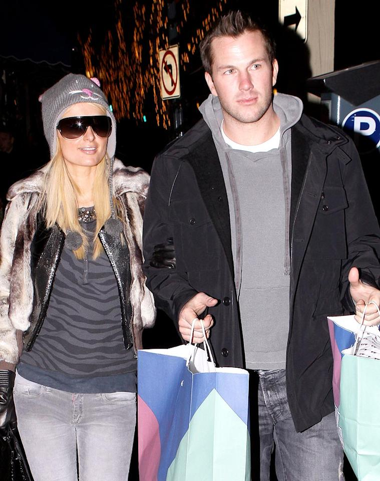"""Looks like Paris Hilton and her main squeeze Doug Reinhardt checked out more than the slopes in Aspen, Colorado. What do you think they have in the bags? More presents for Paris? Ionu/<a href=""""http://www.x17online.com"""" target=""""new"""">X17 Online</a> - December 29, 2009"""
