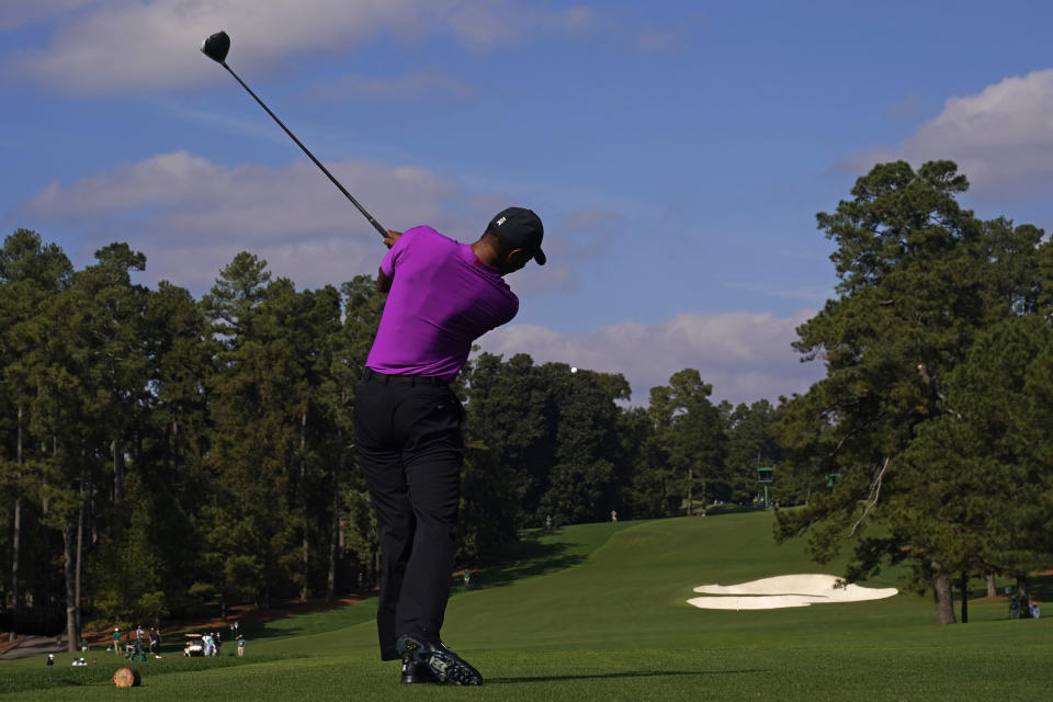 Tiger Woods tees off on the eighth hole during the third round of the Masters golf tournament Saturday, Nov. 14, 2020, in Augusta, Ga. (AP Photo/Chris Carlson)
