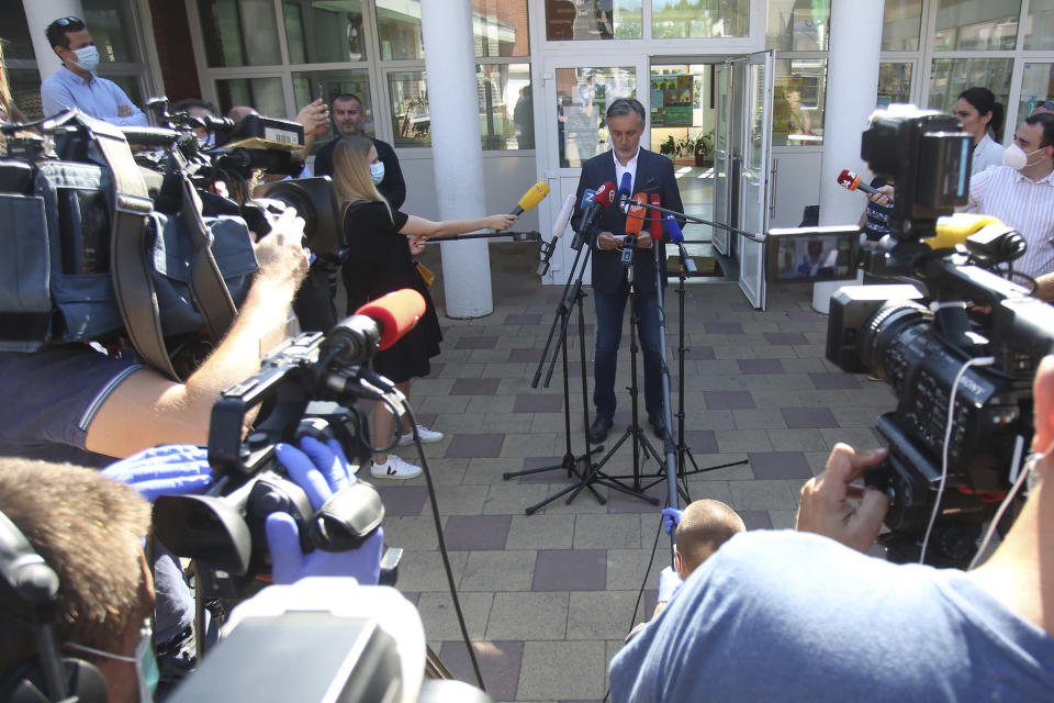 CORRECTS DATE - Miroslav Skoro, leader of the Homeland Movement addresses the media after his vote at a polling station in Zagreb, Croatia, Sunday, July 5, 2020. Amid a spike of new coronavirus cases, voters in Croatia cast ballots on Sunday in what is expected be a close parliamentary race that could push the latest European Union member state further to the right. (AP Photo/Daniel Kasap)