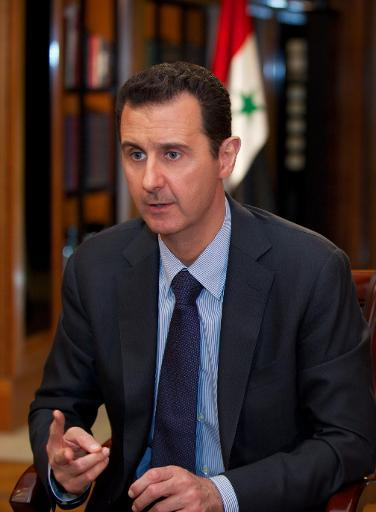 A handout picture released by the official Syrian Arab News Agency (SANA) on October 21, 2013, shows Syrian president Bashar al-Assad giving an interview to Lebanese channel al-Mayadeen in Damascus