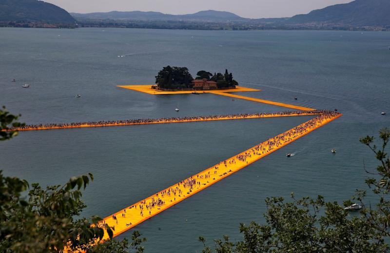 People walking on Christo's 'Floating Piers' on Lake Iseo, Italy in 2016 - Wolfgang Rattay/ REUTERS