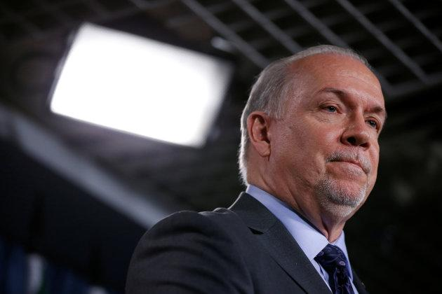 British Columbia Premier John Horgan takes part in a news conference about the state of the Kinder Morgan pipeline expansion on Parliament Hill in Ottawa on April 15, 2018.