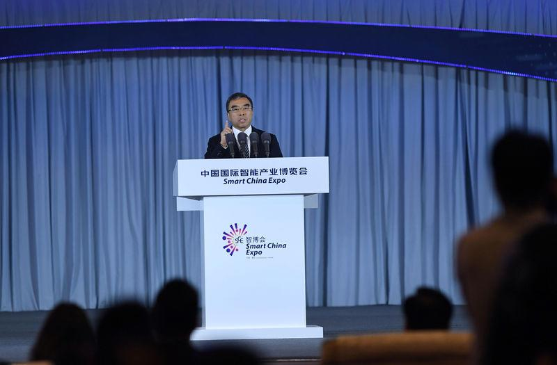 Huawei Technologies Chairman Liang Hua speaks at the first Smart China Expo in Chongqing