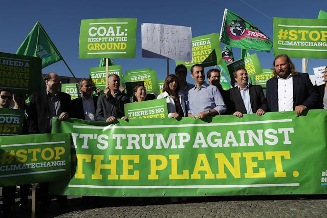 <p>Members of the German Greens Party (Buendnis 90/Die Gruenen), including party co-heads Katrin Goering-Eckardt and Cem Oezdemir (c), protest outside the U.S. Embassy against the announcement by U.S. President Donald Trump the day before that he will pull the USA out of the Paris Agreement on June 2, 2017 in Berlin, Germany. (Sean Gallup/Getty Images) </p>