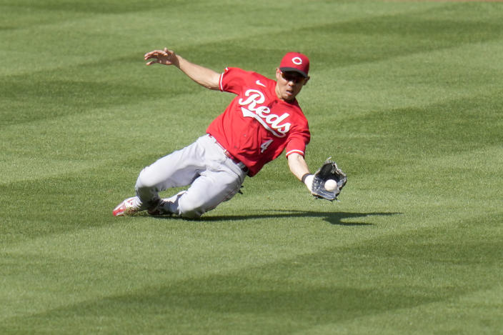Cincinnati Reds center fielder Shogo Akiyama dives to catch a line drive by St. Louis Cardinals' Edmundo Sosa for the final out of a baseball game Saturday, June 5, 2021, in St. Louis. The Reds won 5-2. (AP Photo/Jeff Roberson)