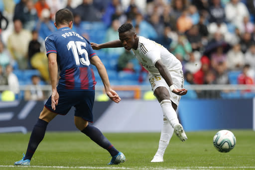 Real Madrid's Vinicius Junior, right, vies for the ball with Levante's Sergio Postigo during the Spanish La Liga soccer match between Real Madrid and Levante at the Santiago Bernabeu stadium in Madrid, Spain, Saturday, Sept. 14, 2019. (AP Photo/Bernat Armangue)