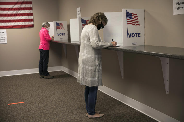 People vote at the Muskingum County Board of Elections on the first day of early voting in Zanesville, Ohio, Tuesday, Oct. 6, 2020. (Maddie McGarvey/The New York Times)