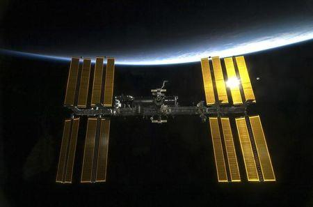 With the Earth in the background, the International Space Station is featured in this image photographed by an STS-130 crew member from aboard the Space Shuttle Endeavour in this photo released by NASA and taken February 9, 2010.   REUTERS/NASA Handout/Files