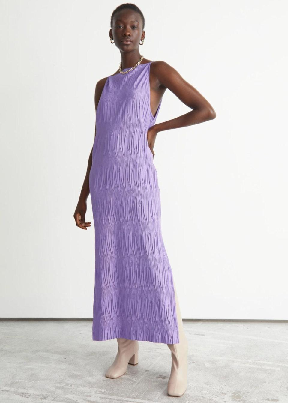 """Whether the wedding backdrop is an oak-filled garden or Gatsby-esque ballroom, this lilac midi has endless styling potential. Pair with your <a href=""""https://www.glamour.com/gallery/comfortable-wedding-shoes?mbid=synd_yahoo_rss"""" rel=""""nofollow noopener"""" target=""""_blank"""" data-ylk=""""slk:heels of choice"""" class=""""link rapid-noclick-resp"""">heels of choice</a> for the dinner portion, then swap for festive flats after hours. $69, & Other Stories. <a href=""""https://www.stories.com/en_usd/clothing/dresses/maxi-dresses/product.pliss%C3%A9-pleated-maxi-dress-purple.0987171001.html"""" rel=""""nofollow noopener"""" target=""""_blank"""" data-ylk=""""slk:Get it now!"""" class=""""link rapid-noclick-resp"""">Get it now!</a>"""