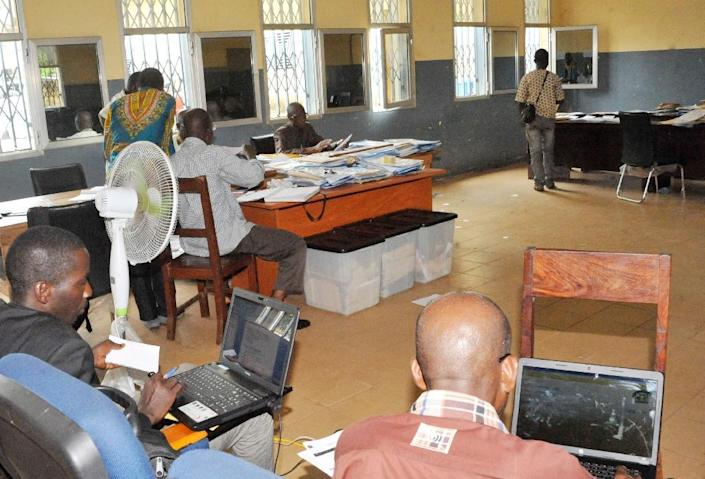 Results published by the Independent National Electoral Commission from areas representing over 90 percent of Guinea's voters showed Alpha Conde winning an outright majority (AFP Photo/Cellou Binani)