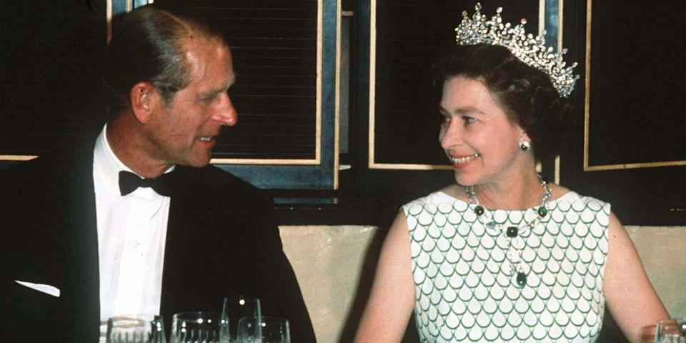 <p>Prince Philip and Queen Elizabeth share a sweet moment at a state banquet.</p>