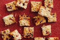 """<p>These sweet little treats take just 15 minutes to put together. The graham cracker crumbs and sweetened condensed milk magically come together to make an ooey‐gooey bottom layer.<b> <a href=""""http://www.foodnetwork.com/recipes/food-network-kitchens/magic-bars.html?oc=PTNR-YahooFood-holiday_cookies_on_yahoo"""" rel=""""nofollow noopener"""" target=""""_blank"""" data-ylk=""""slk:Get the Magic Bars recipe on Food Network"""" class=""""link rapid-noclick-resp"""">Get the Magic Bars recipe on Food Network</a></b>. (<i>Photo: Food Network Kitchen)</i></p>"""