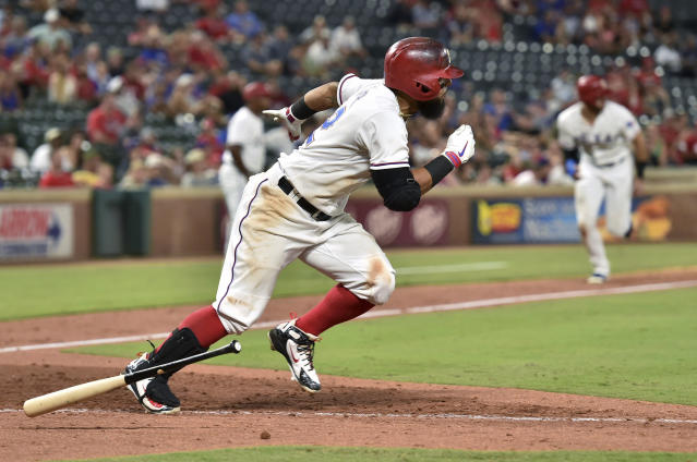 Texas Rangers' Rougned Odor takes off for first on an infield single off Los Angeles Angels relief pitcher Justin Anderson as Joey Gallo, background, comes in to score during the eighth inning of a baseball game Thursday, Aug. 16, 2018, in Arlington, Texas. Texas won 8-6. (AP Photo/Jeffrey McWhorter)