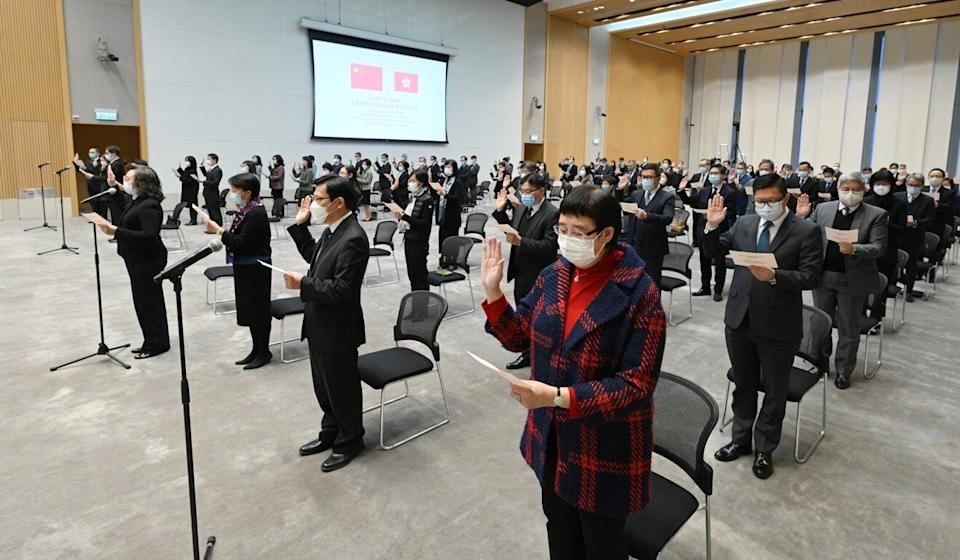 Civil servants take a pledge of allegiance at a ceremony presided over by senior officials last month. Photo: Handout