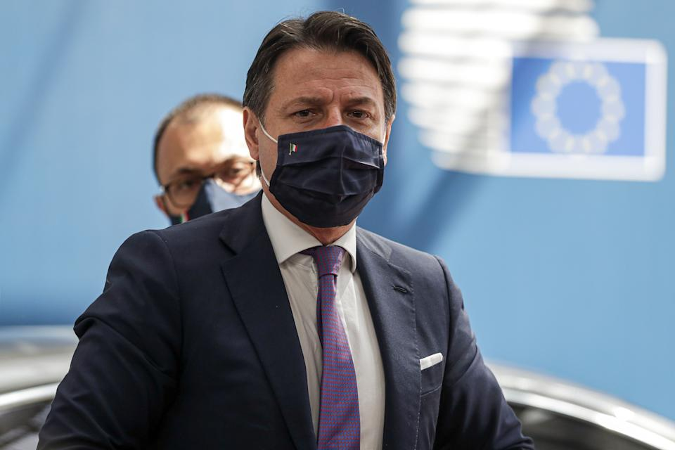 Italy's Prime Minister Giuseppe Conte, wearing a protective face mask, arrives for the fourth day of an EU summit at the European Council building in Brussels, on July 20, 2020, as the leaders of the European Union hold their first face-to-face summit over a post-virus economic rescue plan. - The 27 EU leaders gather for another session of talks after three days and nights of prolonged wrangling failed to agree a 750-billion-euro ($860-billion) bundle of loans and grants to drag Europe out of the recession caused by the coronavirus pandemic (COVID-19). (Photo by STEPHANIE LECOCQ / POOL / AFP) (Photo by STEPHANIE LECOCQ/POOL/AFP via Getty Images) (Photo: STEPHANIE LECOCQ via Getty Images)