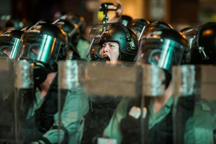 Riot police shout warnings to protesters in Hong Kong's Mong Kok district during renewed clashes between officers and demonstrators calling for democratic reforms (AFP Photo/ISAAC LAWRENCE)