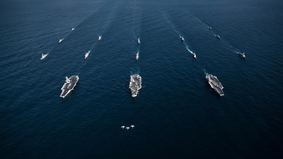 FILE PHOTO: Three F/A-18E Super Hornets fly in formation over the aircraft carriers USS Ronald Reagan (CVN 76), USS Theodore Roosevelt (CVN 71), USS Nimitz (CVN 68) and their strike groups along with ships from the Republic of Korea Navy as they transit the Western Pacific, November 12, 2017.  Courtesy Aaron B. Hicks/U.S. Navy/Handout via REUTERS