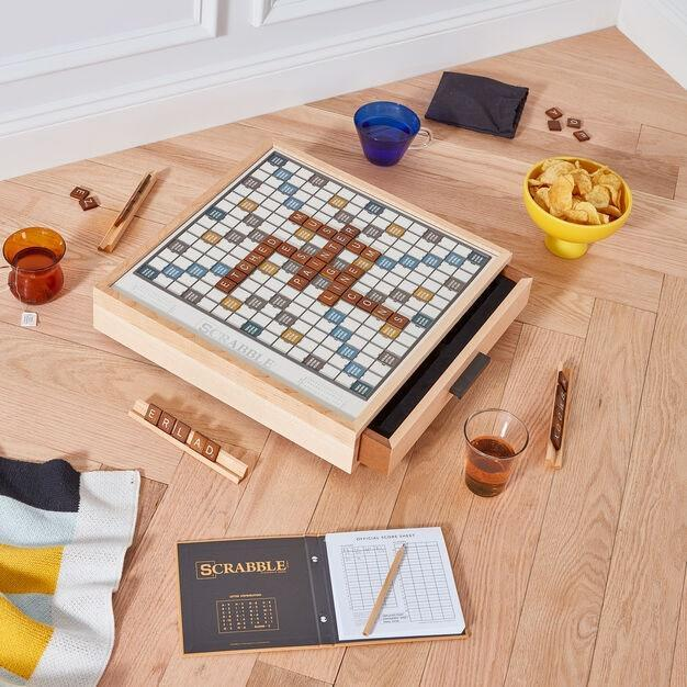 """What better way to celebrate a new home than a family-friendly <a href=""""https://www.architecturaldigest.com/gallery/best-adult-board-games?mbid=synd_yahoo_rss"""" rel=""""nofollow noopener"""" target=""""_blank"""" data-ylk=""""slk:board game?"""" class=""""link rapid-noclick-resp"""">board game?</a> Crowd round the Scrabble board and make some memories. $180, MoMA Design Store. <a href=""""https://store.moma.org/gifts/best-selling-gifts/scrabble-luxe-edition-game/12931-152601.html"""" rel=""""nofollow noopener"""" target=""""_blank"""" data-ylk=""""slk:Get it now!"""" class=""""link rapid-noclick-resp"""">Get it now!</a>"""
