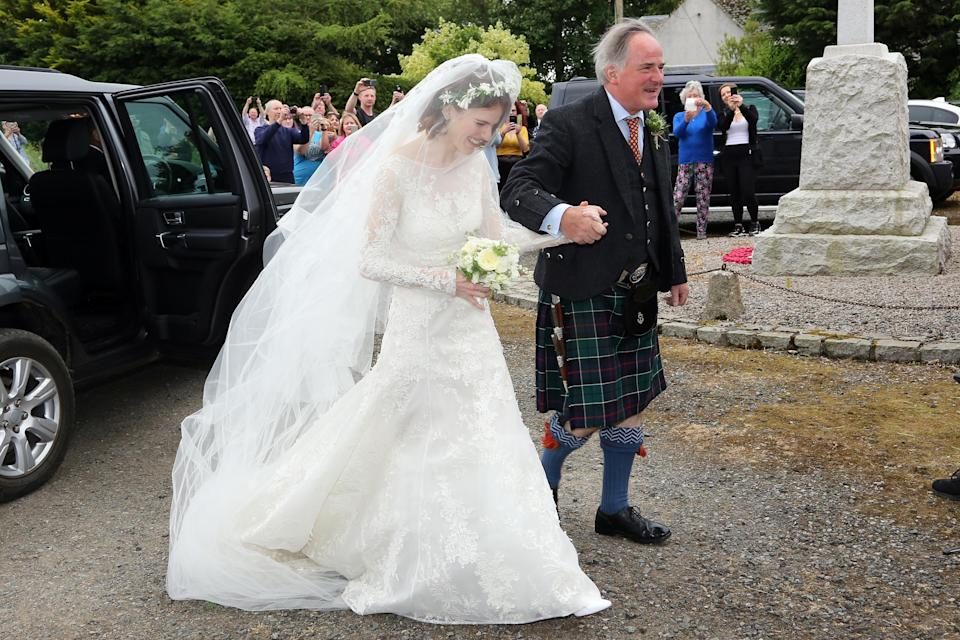 <p>'Game of Thrones' co-stars Rose Leslie and Kit Harington tied the knot in a traditional ceremony at Rayne Church in Aberdeen on 23 June. For the big day, Leslie opted for an Elie Saab dress from the label's SS18 line which cost a cool £20,000. The actress complimented her bridal look with a floor-sweeping veil and floral head garland. <em>[Photo: Getty]</em> </p>
