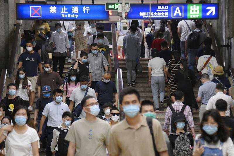 Commuters head to work in Beijing on June 17, amid concern over a possible resurgence in coronavirus infections in the capital. Source: AAP
