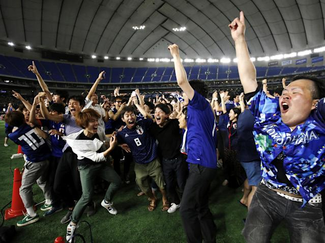 Japan's fans react after Japan's first goal as they watch a broadcast of the World Cup Group H soccer match Colombia vs Japan, at a public viewing event at Tokyo Dome in Tokyo, Japan June 19, 2018. REUTERS/Issei Kato