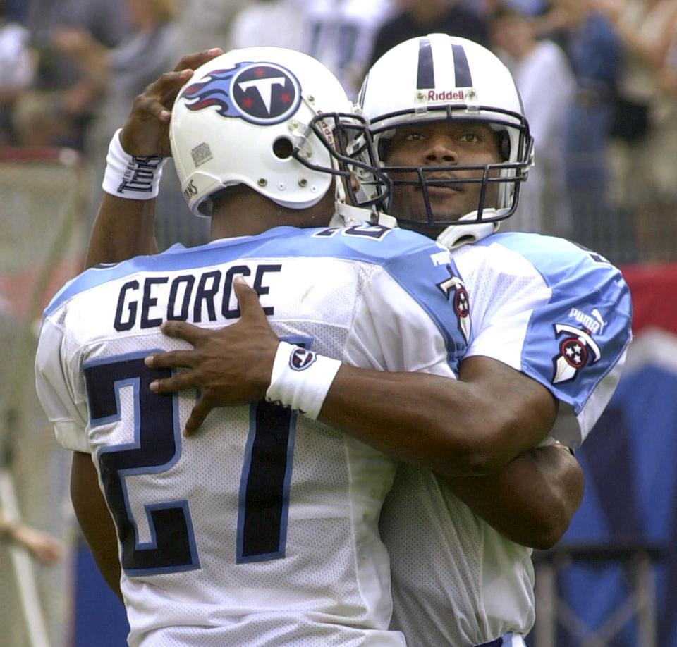 FILE - In this Oct. 1, 2000, file photo, Tennessee Titans quarterback Steve McNair, right, congratulates running back Eddie George after George scored a touchdown against the New York Giants in Nashville, Tenn. The Tennessee Titans retiring Eddie George's No. 27 and the No. 9 of the late Steve McNair has turned from a simple halftime ceremony into a celebration and team reunion. (AP Photo/Mark Humphrey, File)