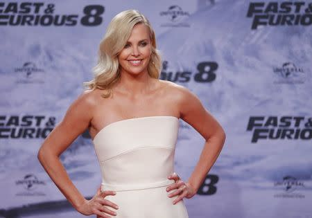 """Actress Theron poses at the premiere of """"Fast and Furious 8"""" in Berlin"""