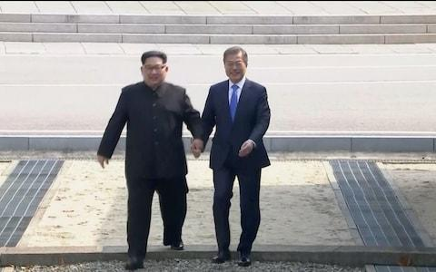 """Kim Jong-un and Moon Jae-in commit to denuclearisation North's leader declares'a new history begins now' President Moon praises Kim's 'bold and courageous' move Moon will travel to Pyongyang for another meeting later this year Kim vs Moon: An heir to a dynasty and a child of refugees Could North Korea summit really convince Kimto give up his nuclear weapons? How Kim Jong-un pulled off a canny PR coup Hailing a """"new era of peace"""", North Korea leader Kim Jong-un and South Korean President Moon Jae-in, sealed their talks on Friday with a joint declaration, and a bear hug, reaffirming their commitment to complete denuclearisation of the Korean Peninsula. The historic summit also agreed to push for three or four-way talksinvolving the US and China to replace the Korean armistice with a peace treaty. In his first ever speech to the world, standing outside the Peace House on the demilitarised border zone, Kim Jong-un first thanked Mr Moon and the South Korean people for their warm welcome. """"It took a long time for the two Koreas to come together and to hold hands and we have long waited for this moment to happen, all of us,"""" he said. """"As I stand here today I can see that South and North Koreans are the same people, they cannot be separated. We are compatriots... We should not be confronting each other, we are the same people and should live in unity. I hope we will be able to live very peacefully in the future, as soon as possible."""" South Korean President Moon Jae-in and North Korean leader Kim Jong Un shake hands after delivering a joint statement during the inter-Korean summit at the truce village of Panmunjom Credit: Reuters He pledged his support for """"permanent peace"""", adding """"we will adopt the Panmunjom declarations while the whole world is watching us. I believe the declaration…will never let us repeat our past mistakes."""" Kim expressed hope that one day South and North Korean citizens would be able to use the same road that he had to reach the summit. """"Panmunjom is a"""