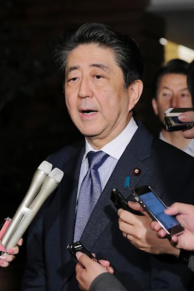 "Japan's Prime Minister Shinzo Abe said his government would be on ""maximum alert"" following the strong earthquake (AFP Photo/JIJI PRESS)"