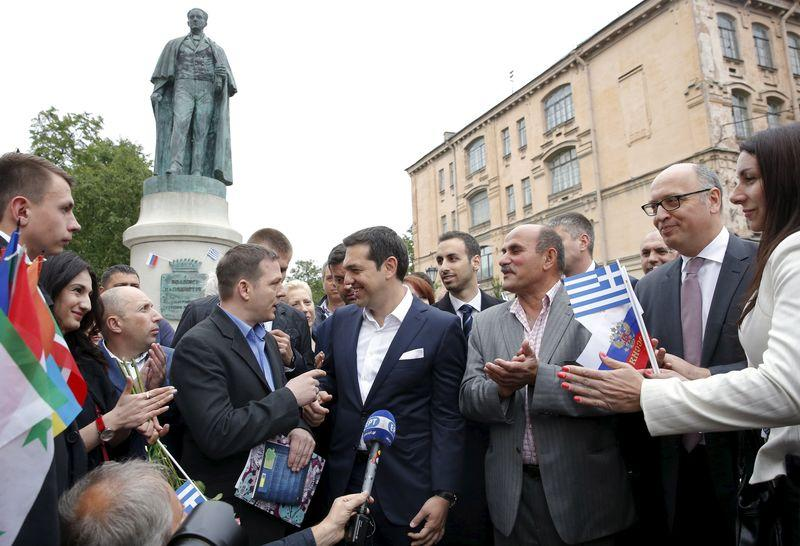 Greek Prime Minister Tsipras speaks with Greek expatriates in front of statue of Russian-born founder of modern Greek state Kapodistrias in St. Petersburg