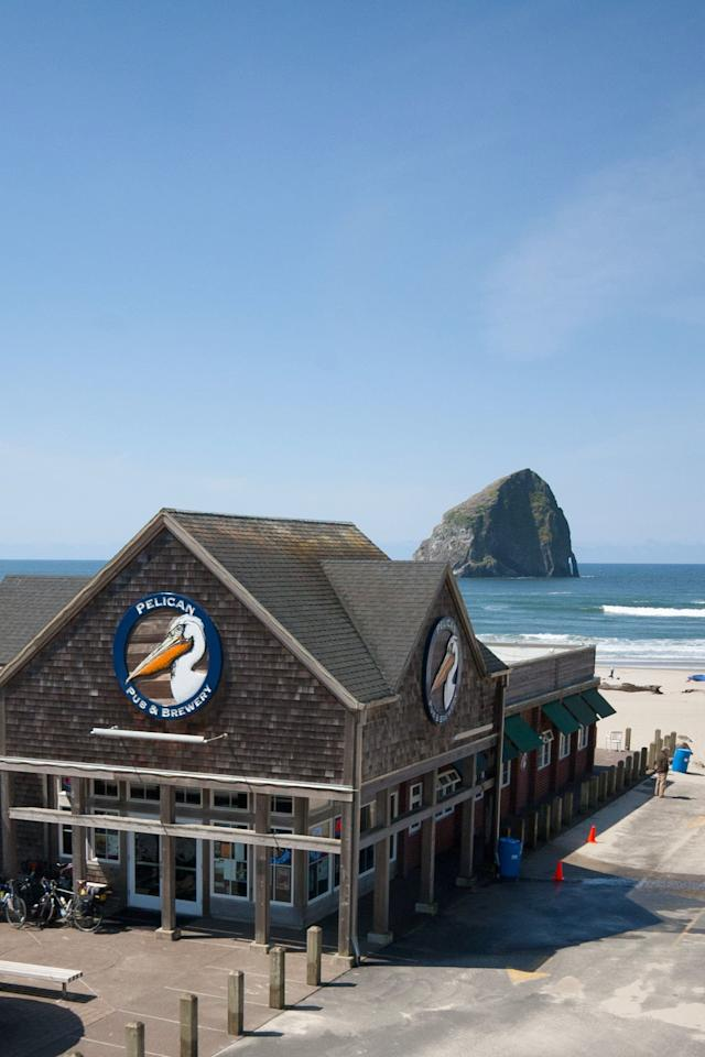 "<p>""Beers on the beach"" is taken to a whole other level at <a href=""http://pelicanbrewing.com/"" target=""_blank"">this brewpub</a> in the shadow of Haystack Rock (one of two 'Haystack Rocks' in Oregon; the other is in Cannon Beach). Settle into a seat at the bar to enjoy the view of the ocean with your Kiwanda Cream Ale, India Pelican Ale, or MacPelican's Scottish Ale, then wander out to the beach patio to watch the dories bob, the surfers surf, and the sun settle over the Pacific.</p>"